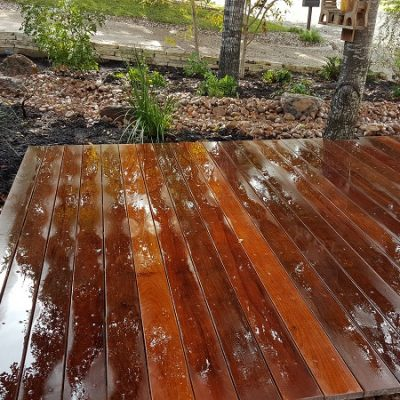 Deck Landscaping Ideas - YardDoc - Austin, TX - Remodel front yard wooden deck and stones
