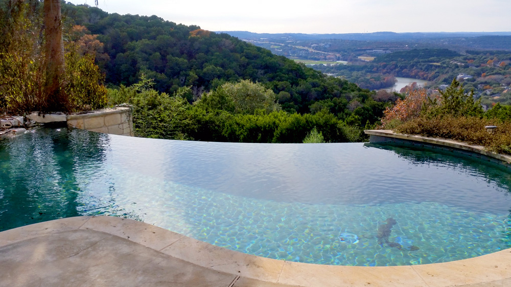 Pool Service - Austin, TX - YardDoc - Scenic view of outdoor pool