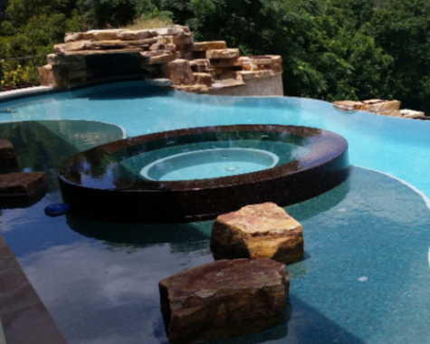 Pool Cleaning Services - YardDoc - Austin, TX - Outdoor pool with hot tub