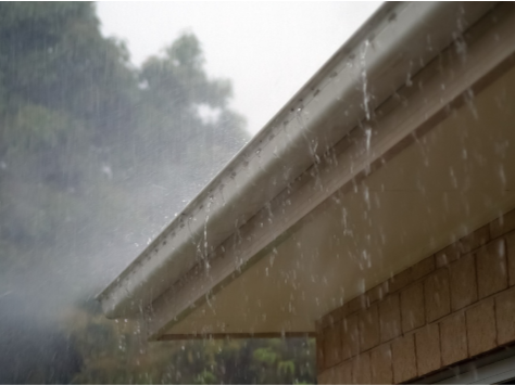 Gutter Cleaning - YardDoc - Austin, TX - Rain overflowing gutter