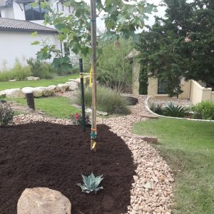 Landscaping Service - YardDoc - Spicewood, TX - River rock and mulch bed