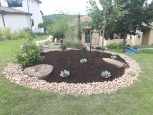 Landscaping - YardDoc - Lakewood, TX - Lakeway Lawn Service - River rock and mulch bed 2