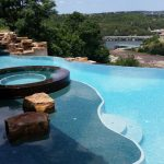 Pool Cleaning - YardDoc - Austin, TX - Outdoor pool with scenic overlook