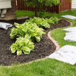 Landscaping Service - YardDoc - West Lake Hills, TX - Mulch in bags next to garden