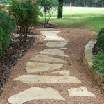 Landscaping with Rocks - YardDoc - Austin, TX - Walkway with Limestone