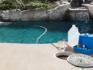 Swimming Pool Inspection- Austin, TX - Chemicals Sitting Next to in Ground Pool - YardDoc