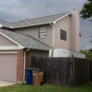 Exterior Painting Austin TX - Two-story beige and brick home